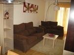 Alquiler de vivienda en Ponferrada (Sala de estar con un sofá triple y uno doble)